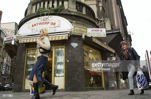 Shoppers pass a diamond jewelry shop October 31 2002 in Antwerp Belgium The gem traders in Antwerp are under pressure to regulate the sales of 'Blood...