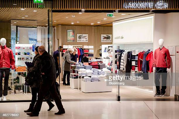 Shoppers pass a Lacoste SA clothing fashion store inside Beaugrenelle mall operated by Apsys SAS in Paris France on Wednesday Feb 4 2015 The European...