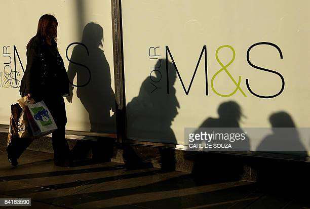 Shoppers pass a Marks and Spencer shop in central London on January 6 2009 Clothingtofood retailer Marks Spencer is set to axe more than 1000 jobs...