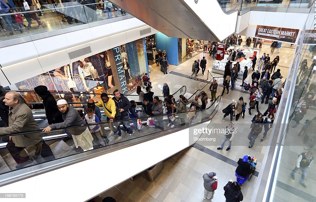 Shoppers pass a Primark clothing store, operated by Associated British Foods Plc, as they travel on an escalator inside the Westfield Stratford City shopping mall in London, U.K., on Thursday, Dec. 27, 2012. Overall Christmas shopping in the U.K. was similar to last year, according to the British Retail Consortium. Photographer: Chris Ratcliffe/Bloomberg via Getty Images