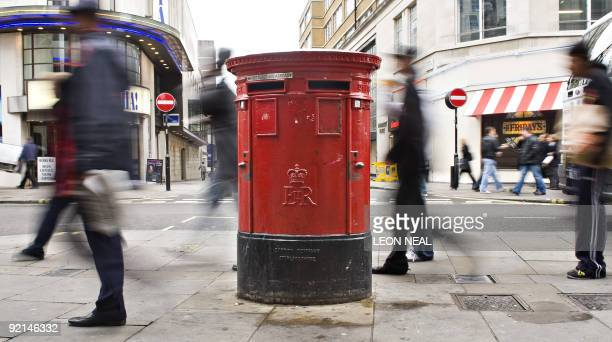 Shoppers pass a Royal Mail postbox in central London on October 21 2009 A last ditch attempt to avoid the planned 24hour strikes by postal workers...