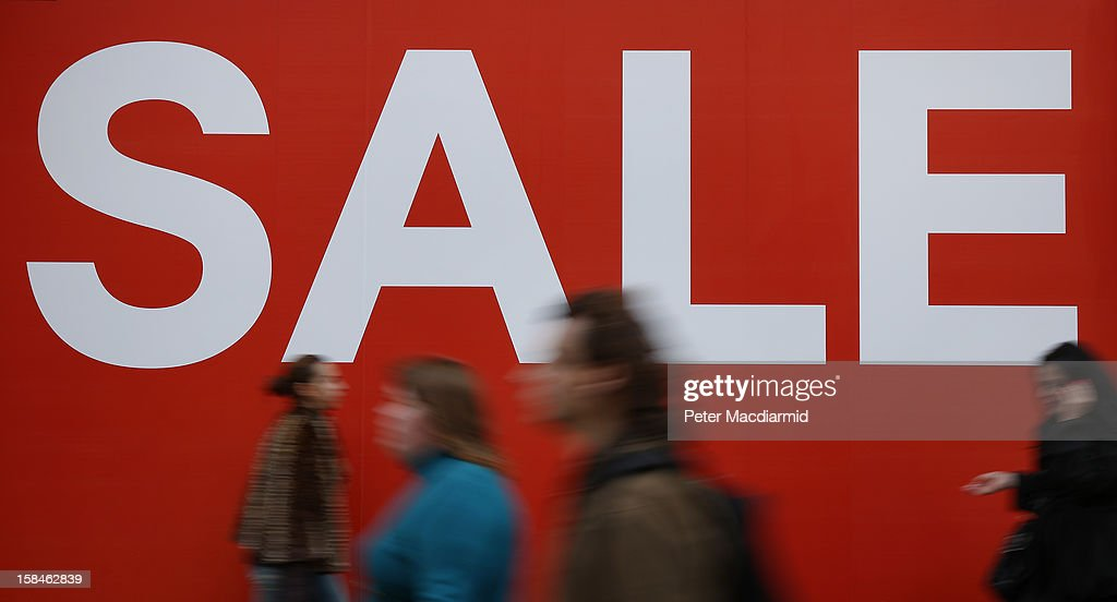 Shoppers pass a sale sign in Oxford Street on December 17, 2012 in London, England. Thousands of shoppers are expected in London's west end in the hunt for Christmas bargains in the next week.