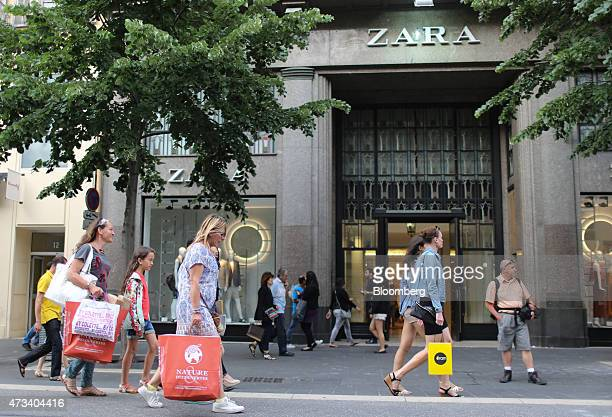 Shoppers pass a Zara fashion store operated by Inditex SA in Nice France on Thursday May 14 2015 The European Commission and the International...