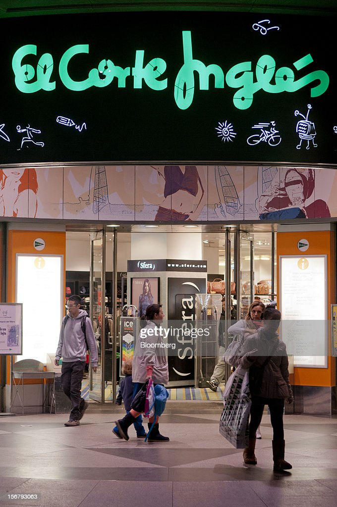 Shoppers pass an entrance to the El Corte Ingles department store at Portal del Angel in Barcelona, Spain, on Tuesday, Nov. 20, 2012. Bank of Spain Governor Luis Maria Linde said the government risks missing its budget targets this year and next, adding to doubts on Prime Minister Mariano Rajoy's ability to cut the deficit amid a five-year slump. Photographer: Stefano Buonamici/Bloomberg via Getty Images