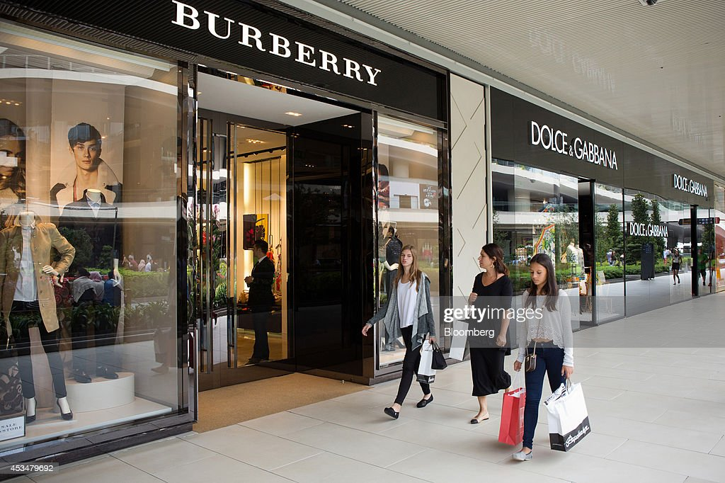 Shoppers pass Burberry Group Plc, left, and Dolce & Gabbana Srl luxury fashion stores in the Zorlu shopping mall in Istanbul, Turkey, on Sunday, Aug. 10, 2014. Investors said they will need to assess the next government's commitment to financial stability should Turkish Prime Minister Recep Tayyip Erdogan assume the presidency this month. Photographer: Kerem Uzel/Bloomberg via Getty Images