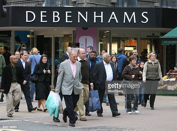 Shoppers pass by a Debenhams department store in London UK Monday October 23 2006 Debenhams full year results are expected tomorrow