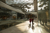 Shoppers pass retail stores inside the Westfield London shopping mall operated by Westfield Corp in London UK on Tuesday Feb 23 2016 The UK's...