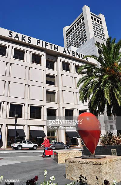 Shoppers pass the Saks Fifth Avenue store located in San Francisco's upscale Union Square shopping district