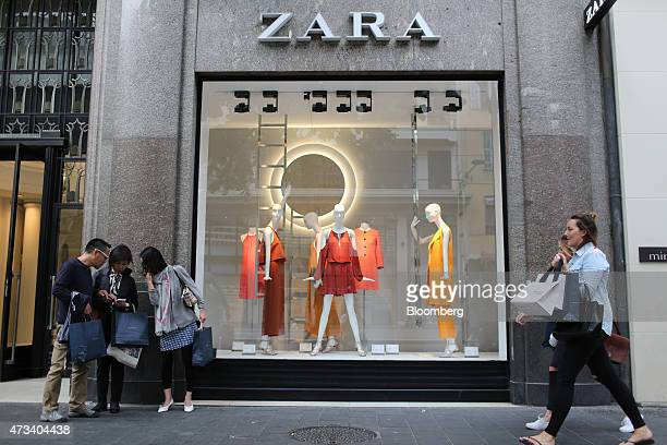Shoppers pass the window display of a Zara fashion store operated by Inditex SA in Nice France on Thursday May 14 2015 The European Commission and...