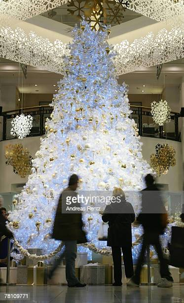 Shoppers past a giant christmas tree at KaDeWe department store on November 27 2007 in Berlin Germany KaDeWe has rolled out its christmas decorations...