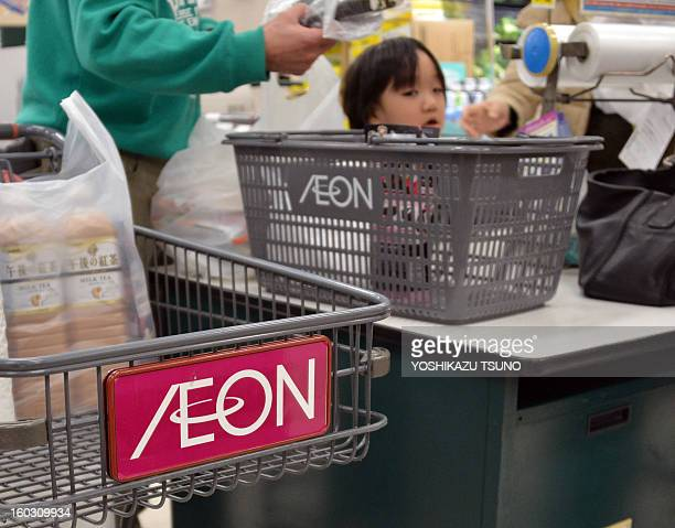 Shoppers pay for goods at an Aeon supermarket in Tokyo on January 29 2013 Aeon said it would embark on big hiring spree aimed at bulking up its...