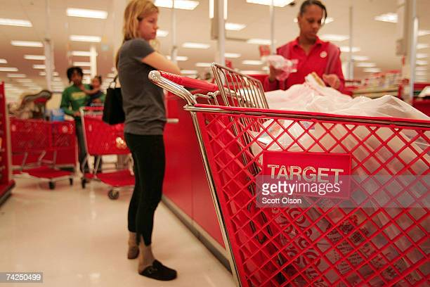 Shoppers pay for their merchandise at a Target store May 23 2007 in Chicago Illinois Today Target Corp reported an 18 per cent increase in their...