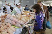 Shoppers peruse a butchers' stand at the Dorogomilovsky Market during a 'slow food' farmers' festival in Moscow on September 25 2010 AFP PHOTO /...
