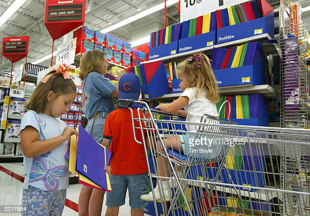 Shoppers peruse notebooks and other backtoschool items in a WalMart store July 28 2003 in Rolling Meadows Illinois WalMart said that sales in the...