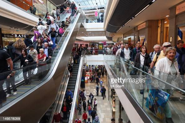 Shoppers peruse the outlets in the giant Westfield Stratford shopping mall adjacent to the Olympic Park on July 31 2012 in London England Trading in...