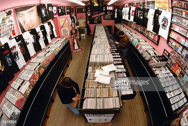 Shoppers peruse the record racks in the Vintage Vinyl record shop in Evanston Il April 12 2000