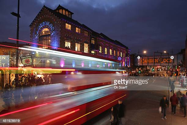Shoppers peruse the shops and stalls in and around Camden Market on November 25 2013 in London England The proposed route of the HS2 high speed rail...
