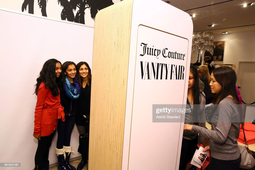 Shoppers pose for photos inside the Vanity Fair & Juicy Couture 'Wild For Gifts' Celebration on November 7, 2013 in New York City.