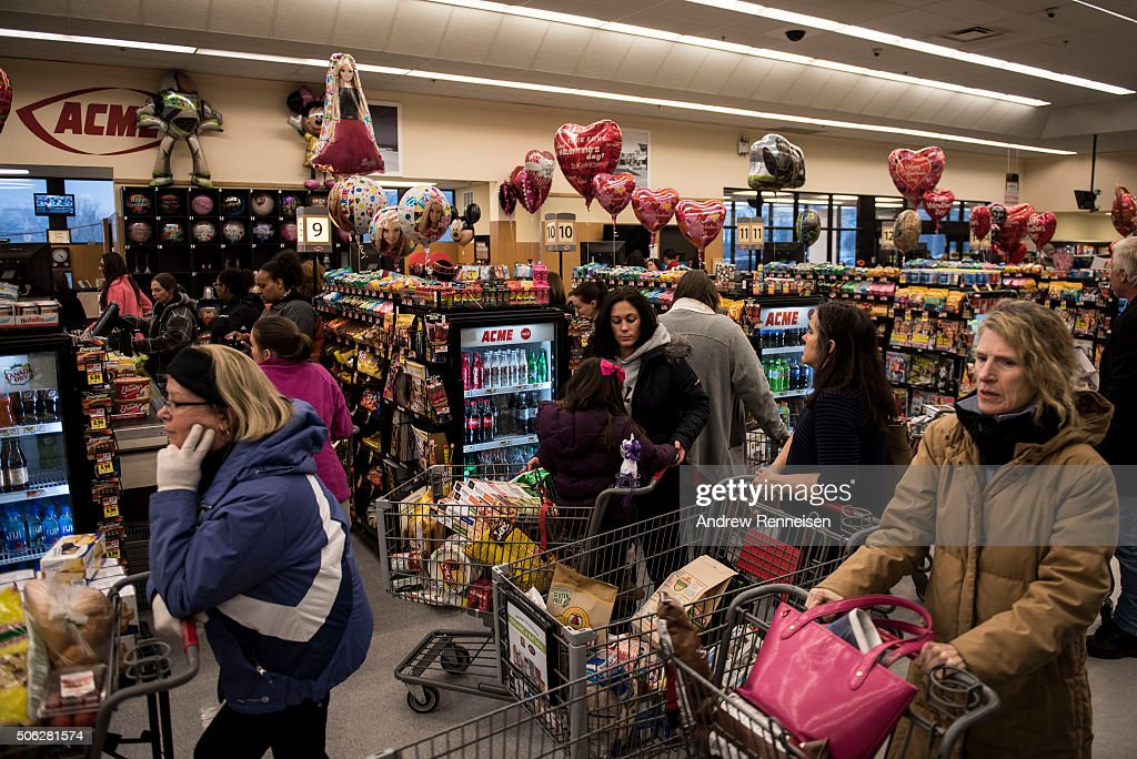Shoppers preparing for the impending winter storm wait in line at an Acme Supermarket on January 22 2016 in Cape May County New Jersey A major...
