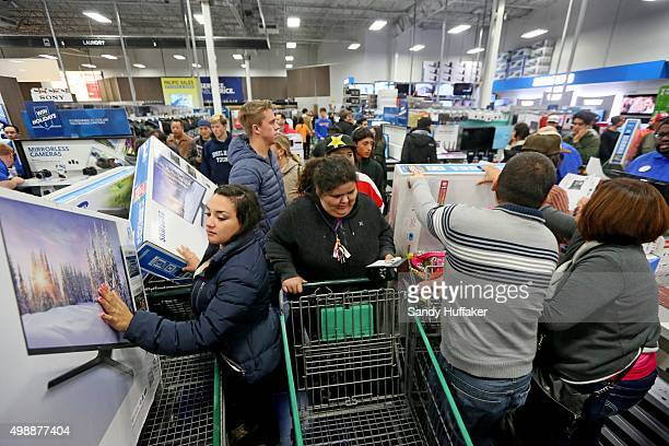 Shoppers purchase electronics and other items at a Best Buy on November 26 2015 in San Diego California Although Black Friday sales are expected to...