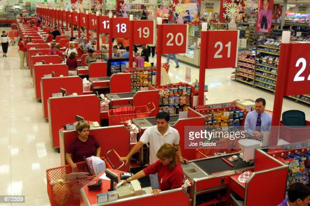 Shoppers purchase their items at the checkout counter in the Target department store at Sawgrass Mills Shopping Center November 19 2001 in Sunrise...
