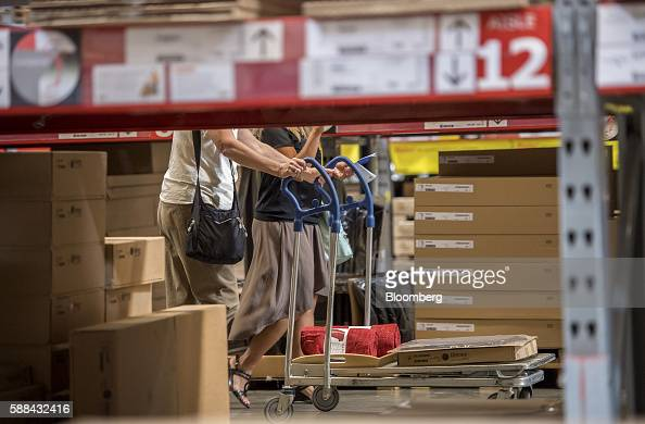 Shoppers push a cart inside an IKEA AB store in Emeryville California US on Tuesday Aug 9 2016 The US Census Bureau is scheduled to release business...