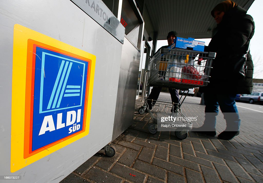 Shoppers push a shopping cart outside an Aldi store on April 8, 2013 in Ruesselsheim near Frankfurt, Germany. Aldi, which today is among the world's most successful discount grocery store chains, will soon mark its 100th anniversary and traces its history back to Karl Albrecht, who began selling baked goods in Essen on April 10, 1913 and founded the Aldi name by shortening the phrase Albrecht Discount. His sons Karl Jr. and Theo expanded the chain dramatically, creating 300 stores by 1960 divided between northern and southern Germany, with Aldi Nord and Aldi Sued, respectively. Today the two chains have approximately 4,300 stores nationwide and have also expanded into other countries across Europe and the USA. Aldi Nord operates in the USA under the name Trader Joe's.