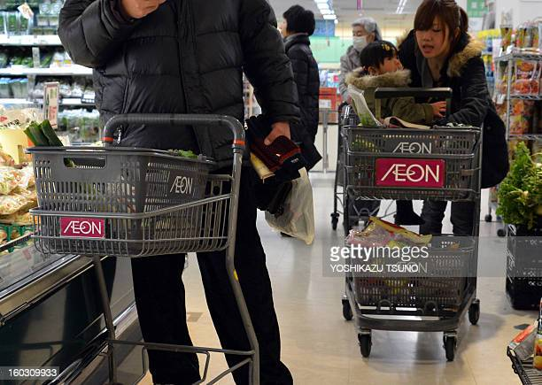Shoppers push shopping carts an Aeon supermarket in Tokyo on January 29 2013 Aeon said it would embark on a big hiring spree aimed at bulking up its...