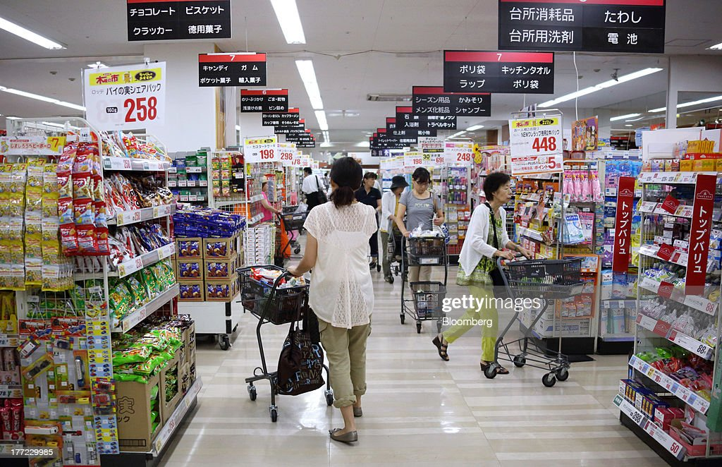 Shoppers push shopping carts at a Daiei Inc. supermarket during a sale jointly held with Aeon Co. at a Daiei supermarket in Urayasu City, Chiba Prefecture, Japan, on Thursday, Aug. 22, 2013. Aeon's acquisition of 48.4 million Daiei shares will take place on Aug. 27 after the completion of tender offer yesterday, according to a statement to the Tokyo Stock Exchange released today. Photographer: Tomohiro Ohsumi/Bloomberg via Getty Images