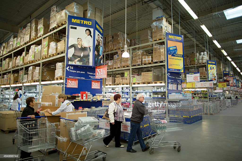 Shoppers push shopping carts through the aisles inside a Metro Cash & Carry store, the Russia unit of Metro AG, in Moscow, Russia, on Friday, Aug. 29, 2014. Metro Cash & Carry has warned that domestic food suppliers are trying to increase some food prices as local produce is substituted for EU, Norwegian and U.S. equivalents which have been sanctioned. Photographer: Andrey Rudakov/Bloomberg via Getty Images