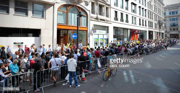 Shoppers queue outside an Apple store in central London on June 24 as the new Apple iPhone 4 goes on sale in Britain Eager Apple fans rushed to...
