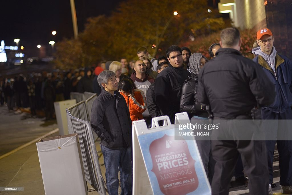Shoppers queue outside of a Best Buy store during their Black Friday sale which started at midnight on November 23, 2012 in Rockville, Maryland. Thanksgiving, the last US holiday undisturbed by mass commercialization, is now victim to the ever advancing Christmas shopping season, with stores welcoming shopaholics before the family turkey can be taken from the oven.