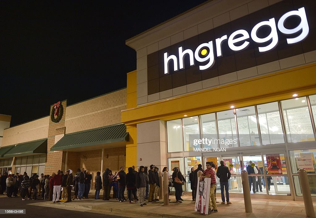 Shoppers queue outside of a hh Gregg electronics which began their Black Friday sales before midnight November 22, 2012 in Rockville, Maryland Thanksgiving, the last US holiday undisturbed by mass commercialization, is now victim to the ever advancing Christmas shopping season, with stores welcoming shopaholics before the family turkey can be taken from the oven. AFP PHOTO / Mandel NGAN