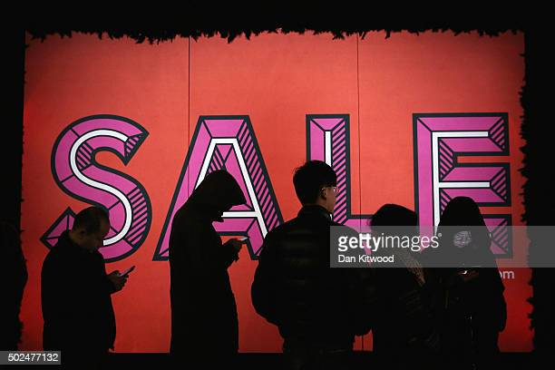 Shoppers queue outside Selfridges ahead of the Boxing Day sales on December 26 2015 in London England Boxing Day is one of the busiest days for...