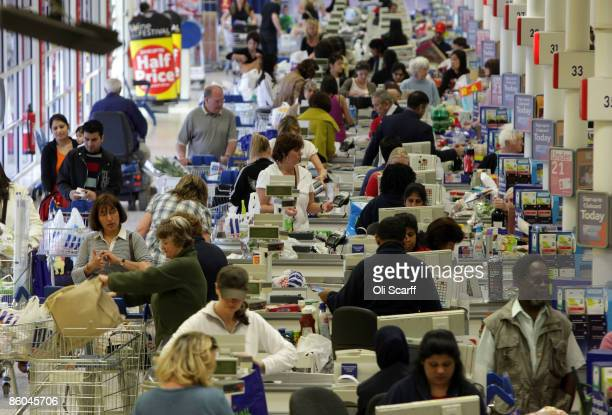Shoppers queue to pay for their shopping in the Tesco Extra superstore on April 20 2009 in New Malden Surrey England The huge New Malden store has...