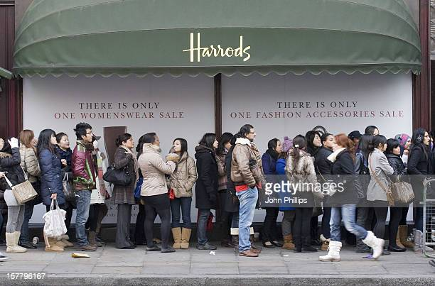 Shoppers Queuing Outside Harrods On The Opening Day Of The Harrods Sale