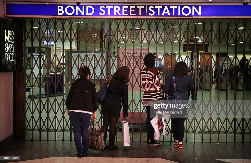Shoppers read a sign explaining that Bond Street underground station is closed due to industrial action on December 26, 2012 in London, England. Thousands of shoppers are in London looking for a bargain in the traditional Boxing Day sales. Shoppers also faced disruptions due to striking London Underground drivers.
