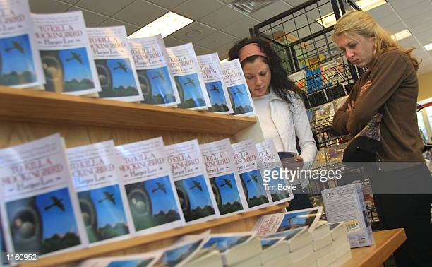 Shoppers read about a Chicago program involving the 40th anniversary edition of Harper Lee's Pulitzer Prize winning novel 'To Kill A Mockingbird'...