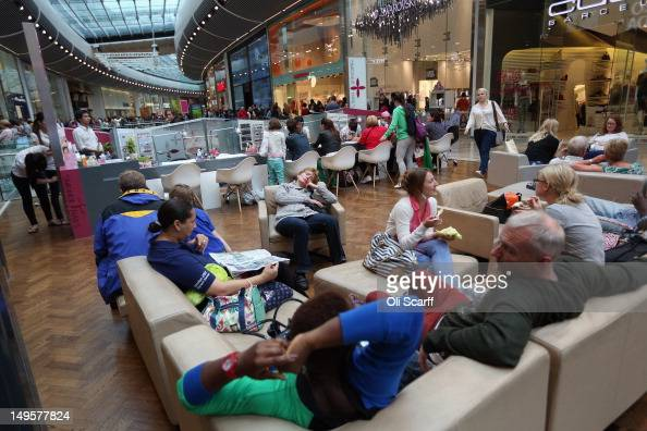 Shoppers rest in the giant Westfield Stratford shopping mall adjacent to the Olympic Park on July 31 2012 in London England Trading in the huge 19...