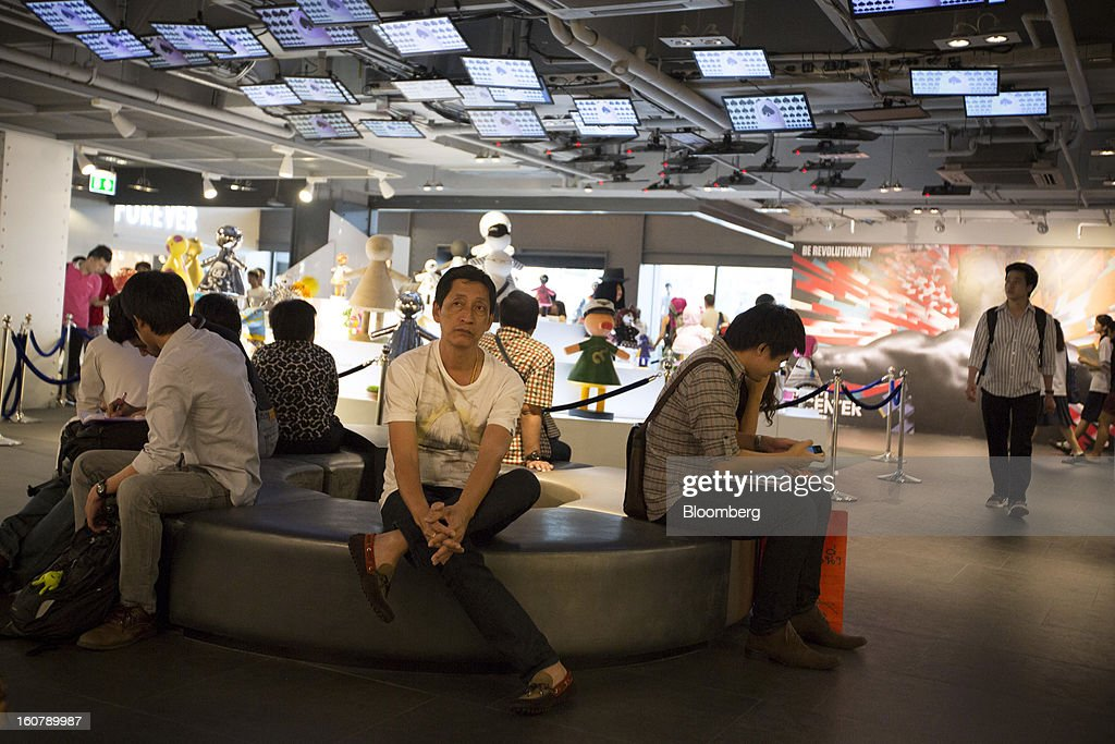 Shoppers rest on a bench inside the Siam Center shopping mall in Bangkok, Thailand, on Tuesday, Feb. 5, 2013. Thai inflation may average 2.8 percent this year, the Bank of Thailand said. Photographer: Brent Lewin/Bloomberg via Getty Images