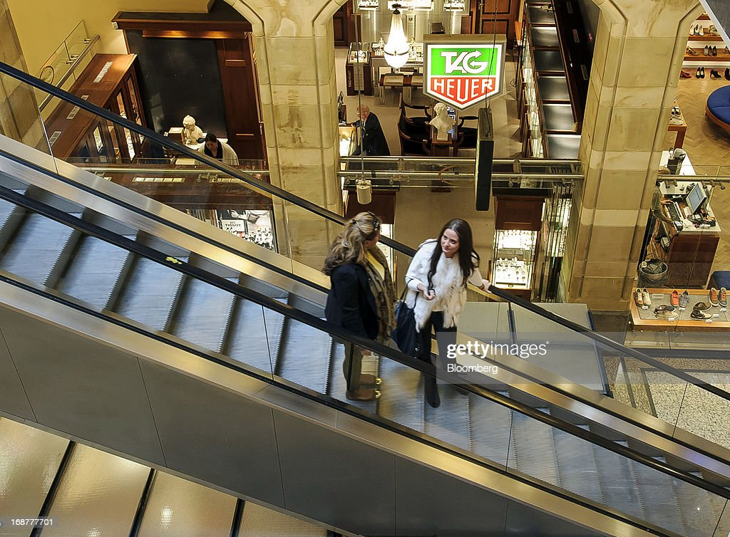 Shoppers ride an escalator and past a jewellery store inside the Magna Plaxa shopping mall in the Dutch city of Amsterdam, Netherlands, on Tuesday, May 14, 2013. Euro-area data this week will probably reveal economic scars of the sovereign debt crisis confirming that the region is now suffering the longest recession since the single currency's creation. Photographer: Jock Fistick/Bloomberg via Getty Images