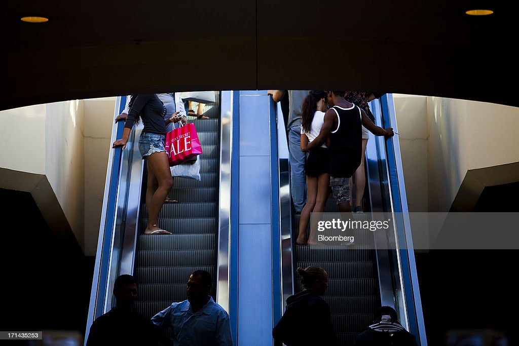 Shoppers ride escalators at the Fashion Valley Mall in San Diego, California, U.S., on Saturday, June 22, 2013. The Bureau of Economic Analysis is schedule to release personal consumption figures on June 26. Photographer: Sam Hodgson/Bloomberg via Getty Images