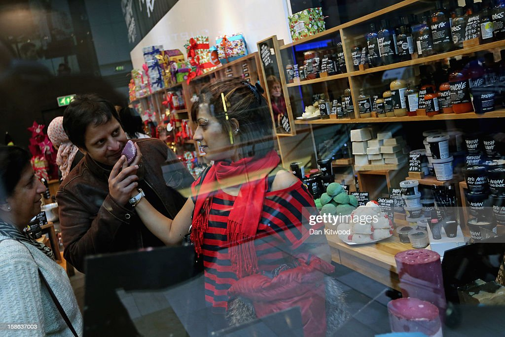 Shoppers smell goods in a soap shop in Westfield Shopping centre in West London on December 22, 2012 in London, England. Today is the final Saturday before Christmas.