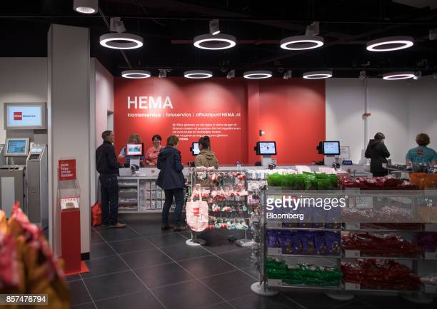 Shoppers stand at a checkout counter inside a Hema BV store in Tilburg Netherlands on Wednesday Oct 4 2017 Privateequity firm Lion Capital LLP which...