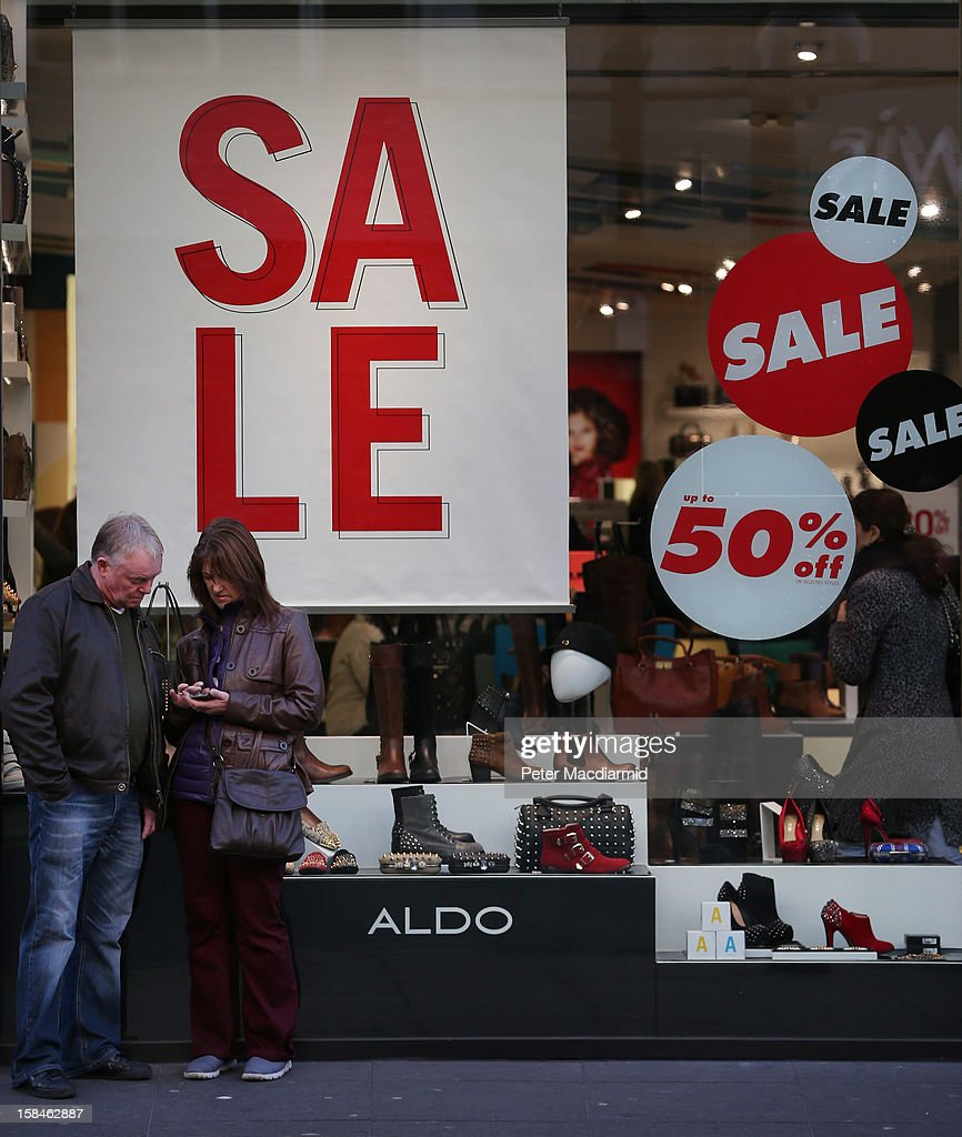 Shoppers stand in Oxford Street on December 17, 2012 in London, England. Thousands of shoppers are expected in London's west end in the hunt for Christmas bargains in the next week.