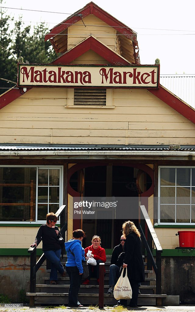 Shoppers stand outside the Matakana Famers Market in Matakana October 11, 2008 near Auckland, New Zealand. Farmers markets in New Zealand are rapidly growing in popularity as people seek more healthy, fresh and nutritious alternatives to supermarket food.