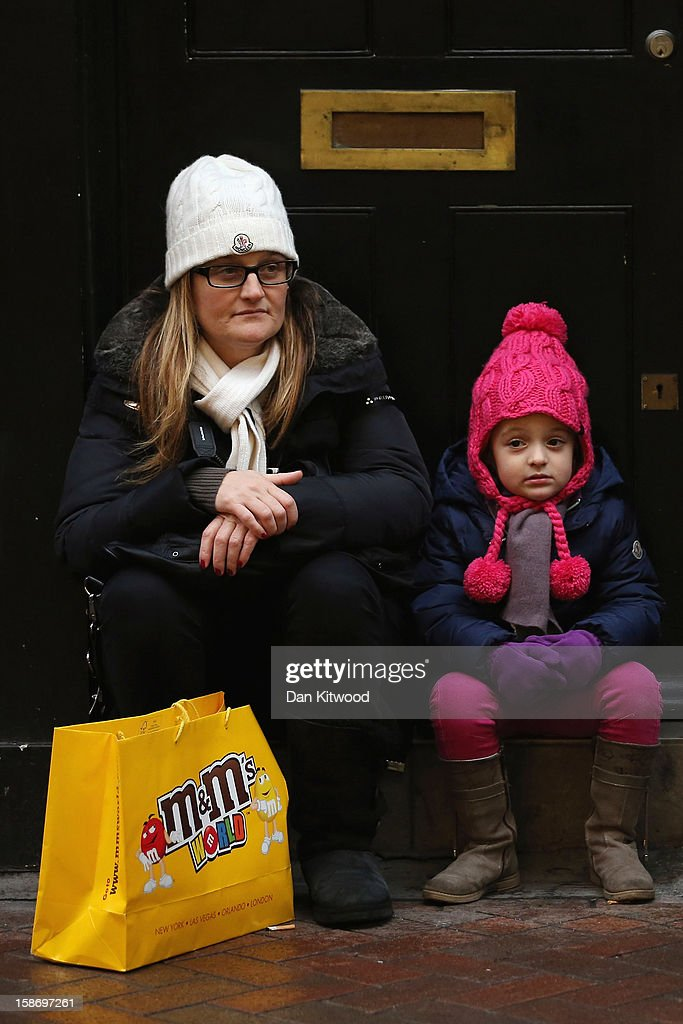 Shoppers take a break on Carnaby Street on December 24, 2012 in London, England. Many high street retailers have started their sales two days early this year on what is expected to be the busiest shooping day of the year.