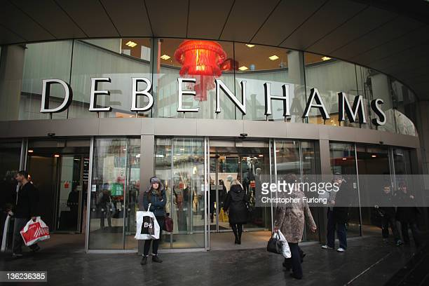 Shoppers take advantage of the post Christmas sales outside the Liverpool branch of Debenhams on December 29 2011 in Liverpool England In spite of...