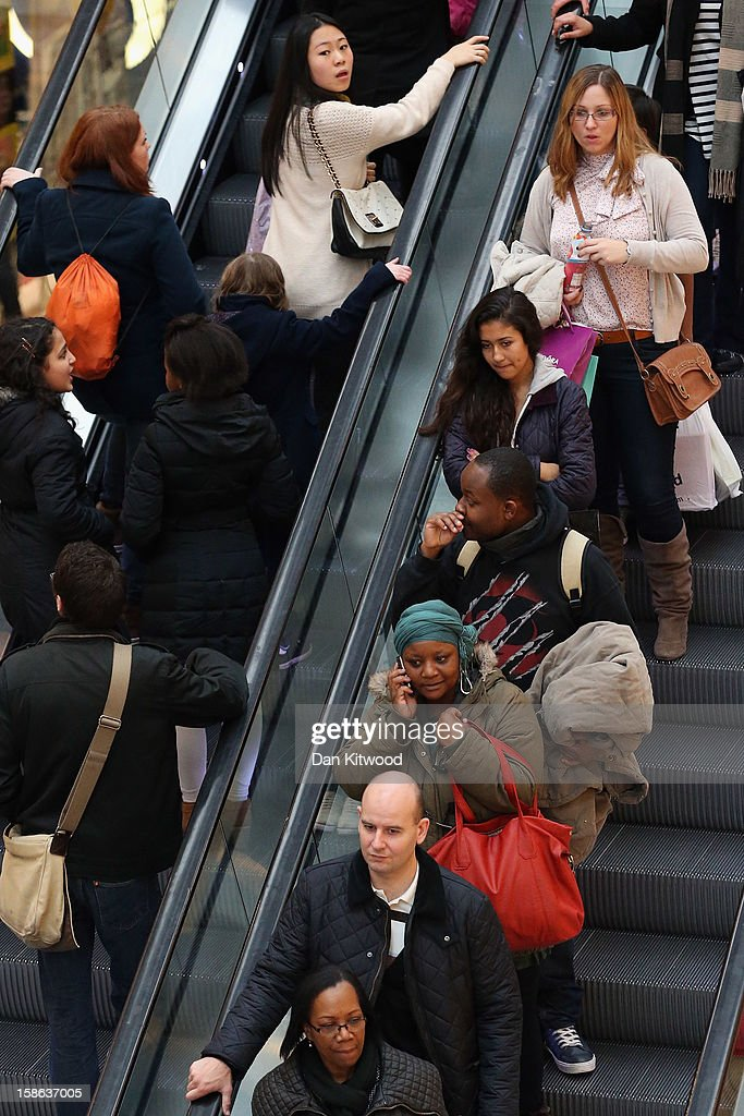Shoppers take the escalator in Westfield Shopping centre in West London on December 22, 2012 in London, England. Today is the final Saturday before Christmas.
