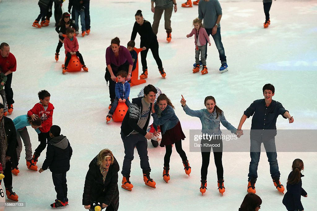 Shoppers take to the ice rink in Westfield Shopping centre in West London on December 22, 2012 in London, England. Today is the final Saturday before Christmas.